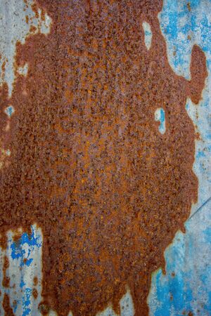 Blue and orange background with ink texture on metal. Blue colored abstract.