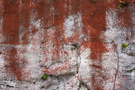 Wall texture painted in white and red, detail of rural art and vintade.