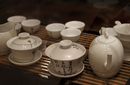 teacups: Asian traditional teapot and teacups made from ceramic and porcelain. Stock Photo