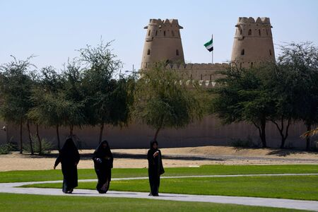 burqa: Arab women in burqa in front of a fort