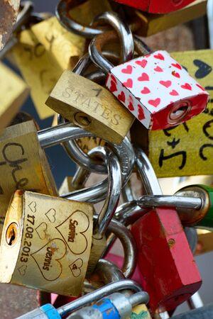 Colorful love padlocks on a fence