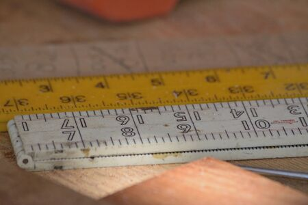 rulers: Different rulers with measurements on a workbench