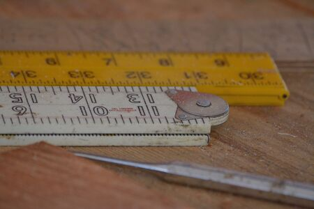 workbench: Different rulers with measurements on a workbench