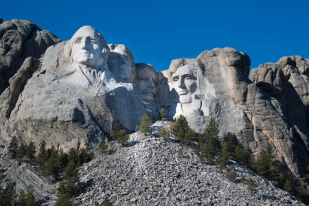 The presidential faces of Mount Rushmore with blue sky in South Dakota, USA Editoriali