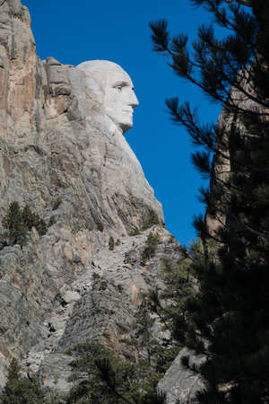 Mount Rushmore face of George Washington profile president faces in Black Hills of South Dakota, USA