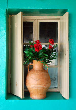 beautify: window, vase with roses and colorful wall