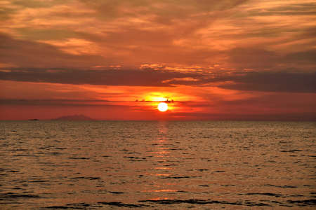 red sky: red sunset over sea and cloudy sky