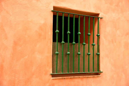 grates: window on colorful wall