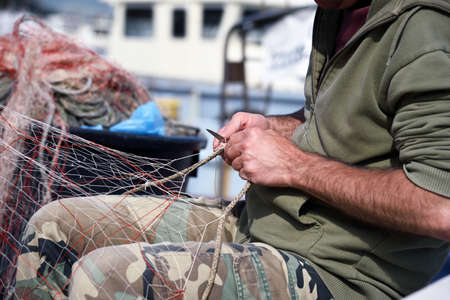 hands work: hands at work on fishing net