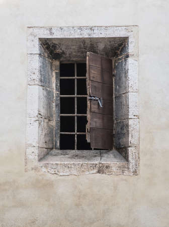 grates: ancient window on white wall Stock Photo