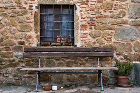 window bench: old house with window and bench