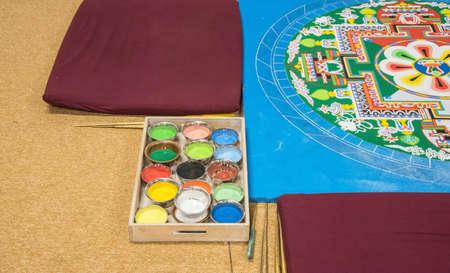 spiritual meditation creation: Tibetan mandala with colored sand Stock Photo