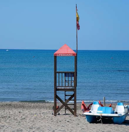 bather: Lifeguard tower at sea