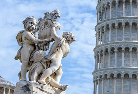 leaning tower of pisa: statues of angels and the leaning tower, Pisa, italy