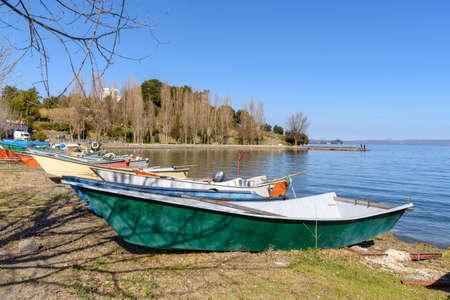 ishing boat on beach at the village of Marta, Bolsena lake, Italy