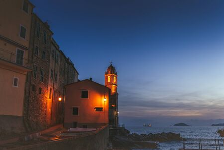 Night view of the old church, lighthouse in Tellaro, Ligurian province, Italy