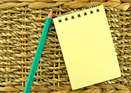 Image of a yellow notepad on the background of ropes photo