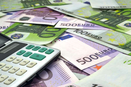 Image of calculator with money 100 and 500 euro