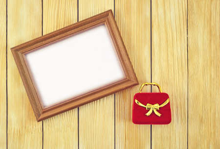 laths: photo frame and gift box on background of wooden laths Stock Photo