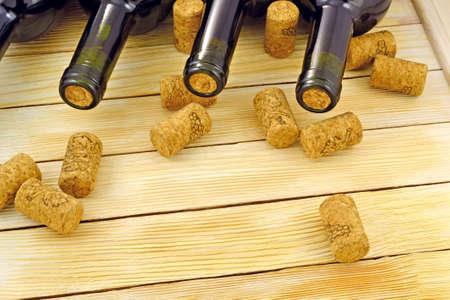 Image of wine bottles on wooden slats background photo