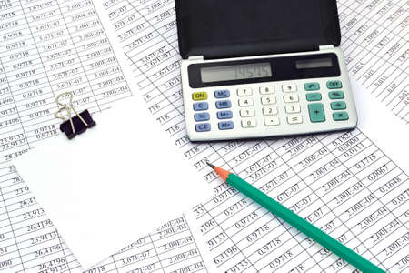 Image the calculator with note paper and financial the numbers photo