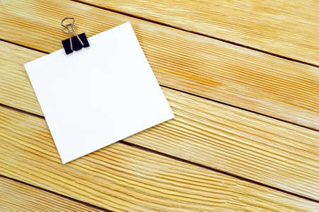 Image blank paper notes on a background of wooden boards photo