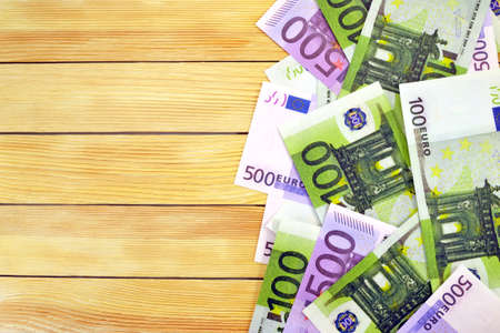 Cash Flow: Euro money image on the background wooden boards
