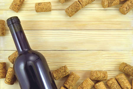 semisweet: Bottle of red wine with a cork on the background of wooden planks Stock Photo