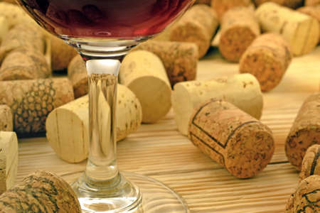 lath in modern: Image of glasses of red wine on the background of corks