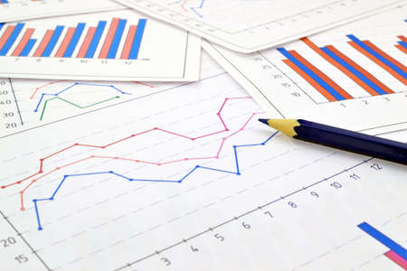 Image of financial tables graphs numbers for work business and economics