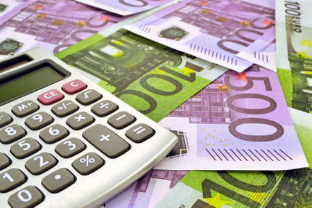 finance background: Photo of calculator with money 100 and 500 euro
