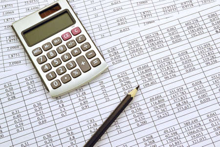 finance background: Photo the calculator with financial the numbers and pencil