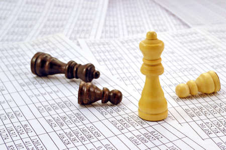 reckon: Chess pieces are printed on numbers in the table Stock Photo
