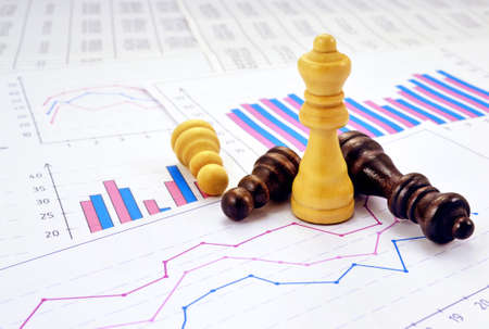 Photos chess pieces with graphs and diagrams Reklamní fotografie