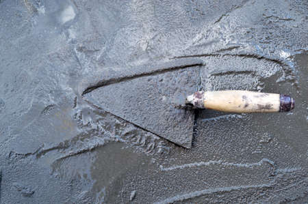 Trowel standing on a poured concrete
