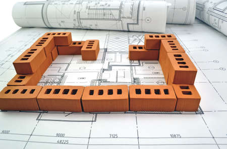 Photos of project drawings and brown bricks