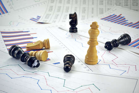 Photo of chess pieces with graphs and diagrams Reklamní fotografie