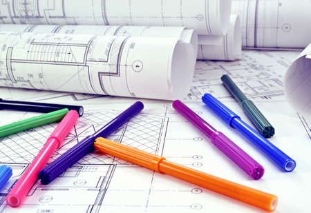 Photos of colored markers on project drawings