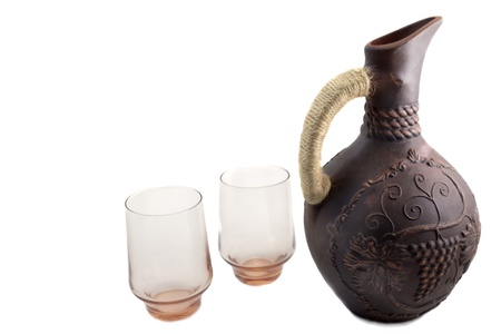 red clay: The jug for wine with the handle braided by a lace, is made of red clay, decorated with an ornament, presented on a white background