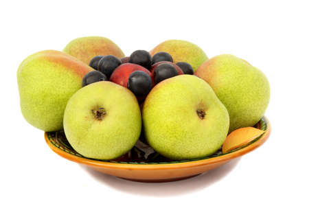 Large ripe pears, plums on a ceramic plate. Presented on a white background. photo