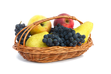 Ripe pears, apples and grapes in a wicker basket. Presented on a white background. photo