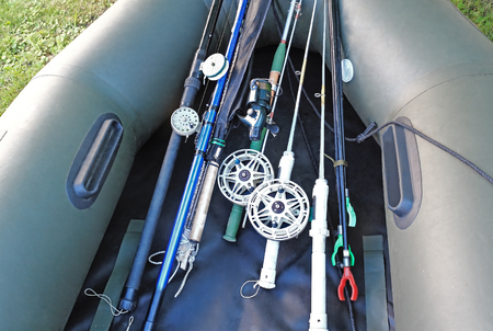 pressurized: Rods and spinning prepared for fishing, lie in pressurized rubber boat