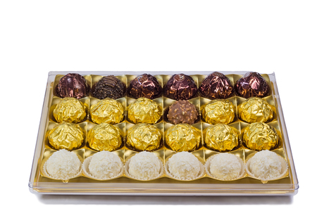 Fragment of the open blue boxes of chocolates. Presented on a white  photo