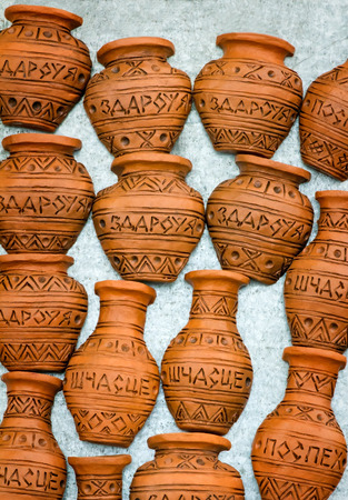 happiness or success: The souvenirs imitating clay jugs with inscriptions: health, happiness, success.