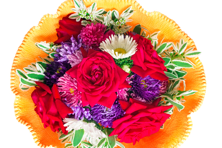 Beautiful bouquet from red roses, camomiles, blue asters in decorative registration  It is presented on a white background  photo