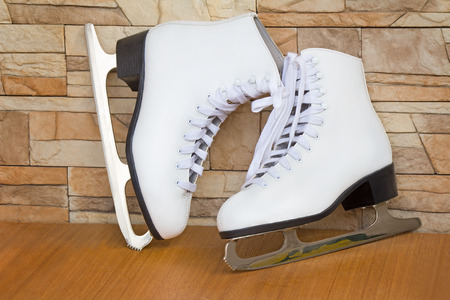 The skates and graceful boots of white color for figure skating on ice for women. photo