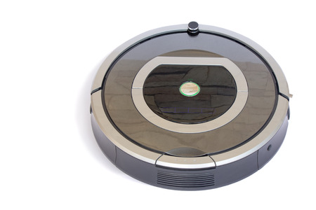 roundish: The automated robot vacuum cleaner of a roundish form, can make cleaning in hard-to-reach spots. It is presented on a white background.