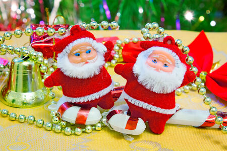 dwarf christmas: Decorations for Christmas trees: two cute dwarf bell and gifts. Stock Photo