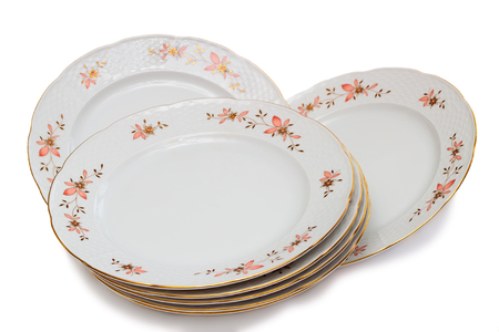 ornamentation: White plates with delicate ornamentation. Presented on a white background.