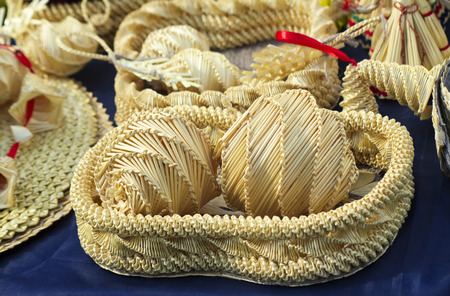 Woven from beautiful straw boxes and other Souvenirs placed on the table, covered with blue silk. This products for sale at the fair. photo